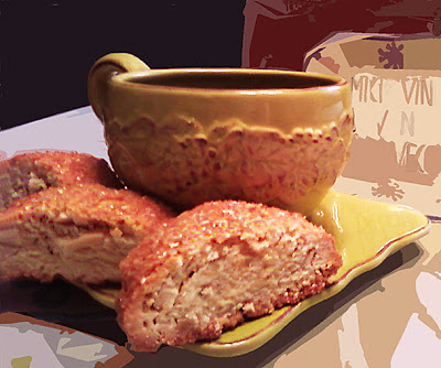 Image of Almond Anise Biscotti on a saucer with a cup of coffee