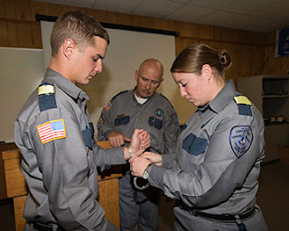 An academy class on proper handcuffing techniques.