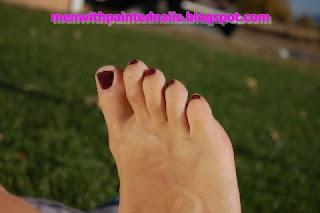 Male toes painted with OPI nail polish called Borris and Natasha