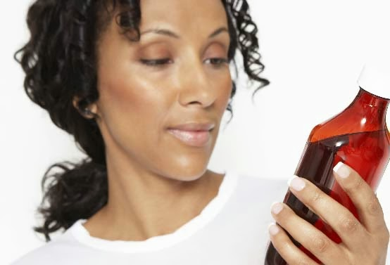 Woman With Blood Pressure Taking Cold Medicine
