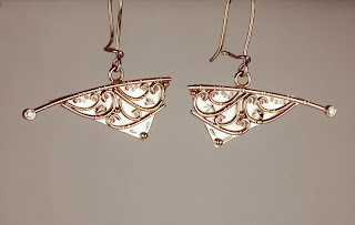 18k white gold pendulum style earrings with diamond accents