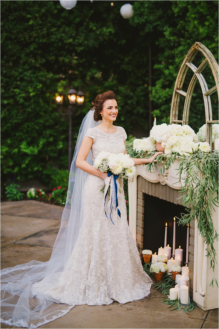 Elegant bride in lace gown in front of altar // Photo by Closer to Love Photography via @thesocalbride