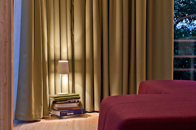 Brown Wooden Floor and Dark Yellow Colored Curtains