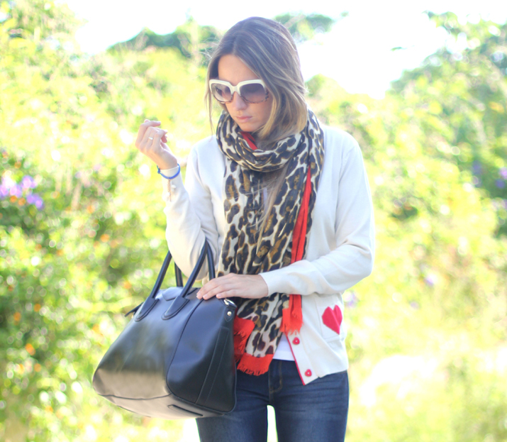 Blogger wearing jeans and animal print scarf