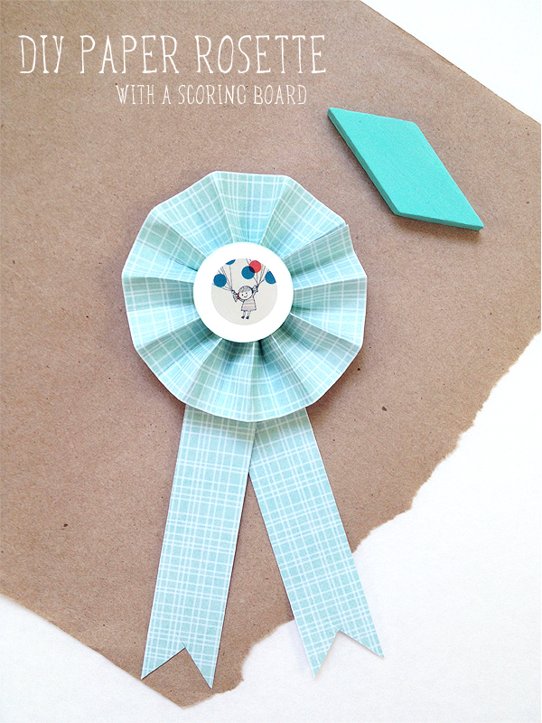 How to make a paper rosette make valentine paper rosettes how to diy paper rosettes with a scoring board mightylinksfo