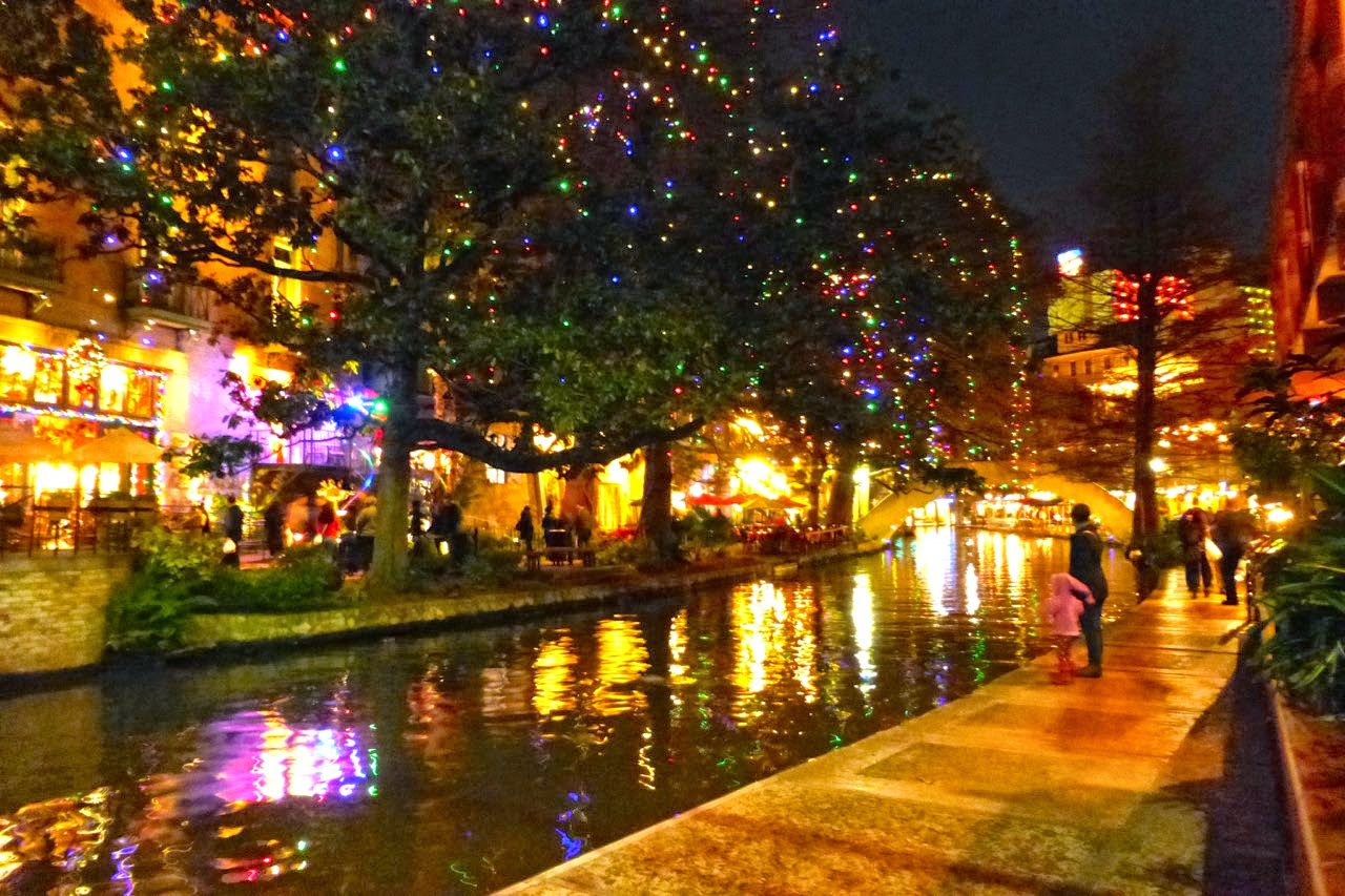 san antonio riverwalk at night during the christmas season