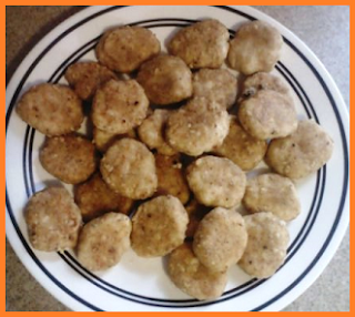 Large dinner plate with a large amount of nuggets piled on top of it