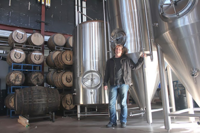 River North Founder and Head Brewer Matt Hess poses with his new tanks.