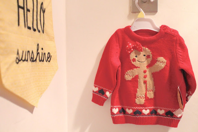 red baby christmas jumper from matalan with gingerbread man wearing bow