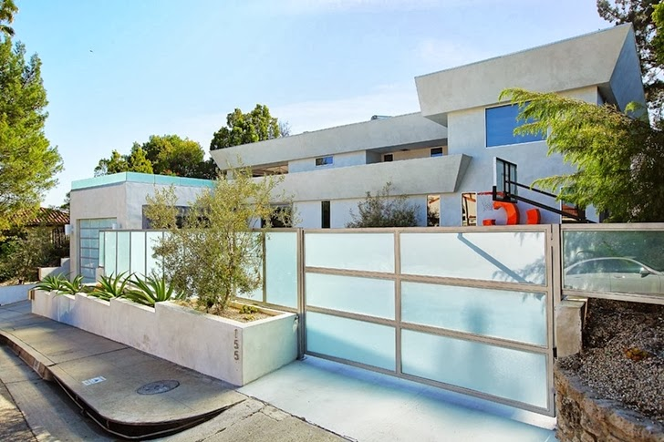 Gate and street fence of Modern Beverly Hills House with open interiors