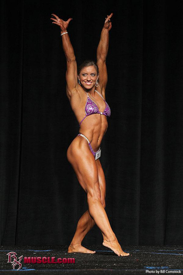 Holland Canter Posing Her Muscles At The 2012 NPC Iron Man Natural