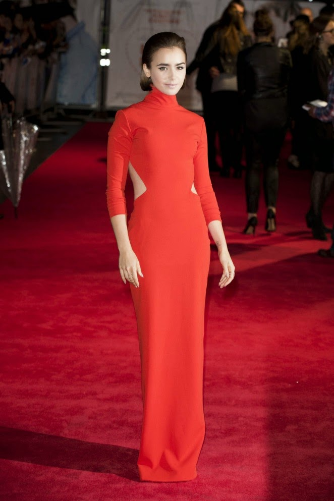 Lily Collins stuns in a crimson Solace London dress at the 'Love, Rosie' premiere in London
