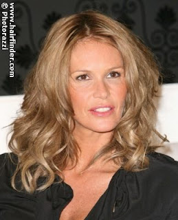 Elle MacPherson with curly hair