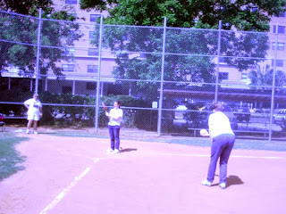 Debbie pitching to Shelby, beep baseball outing