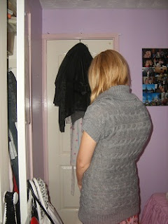 My scoliosis before scoliosis surgery in a jumper showing my rib hump