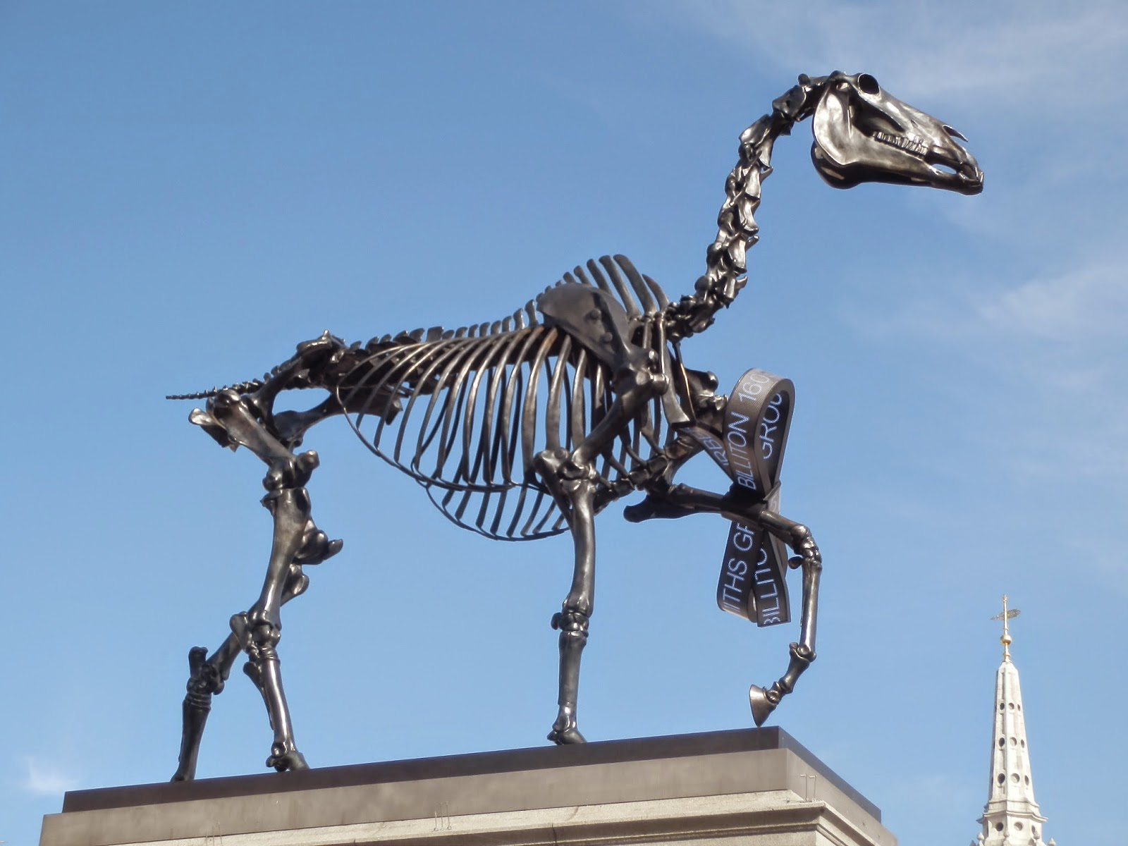 Joseph scissorhands hans haacke gift horse gift horse depicts the bronze skeleton of a horse with a bow tied around its foreleg the bow has live scrolling information from the london stock exchange negle Images