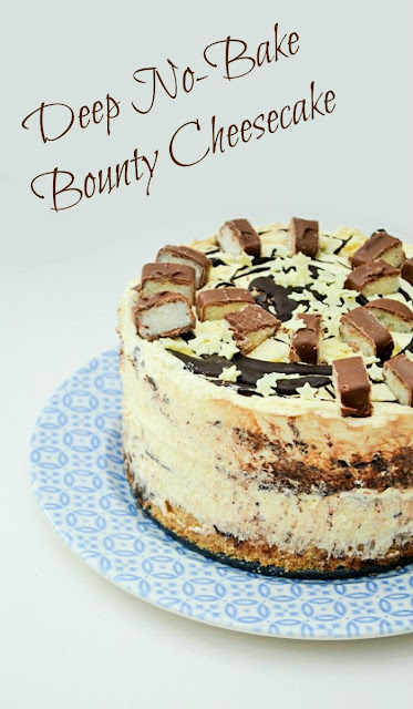 Deep No-Bake Bounty Coconut Cheesecake. An easy no bake cheesecake with a biscuity base, a thick layer of cheesecake filling flavoured with coconut and chocolate, topped with more melted chocolate, generous slices of Mars Bounty bar and white chocoalte sprinkles.