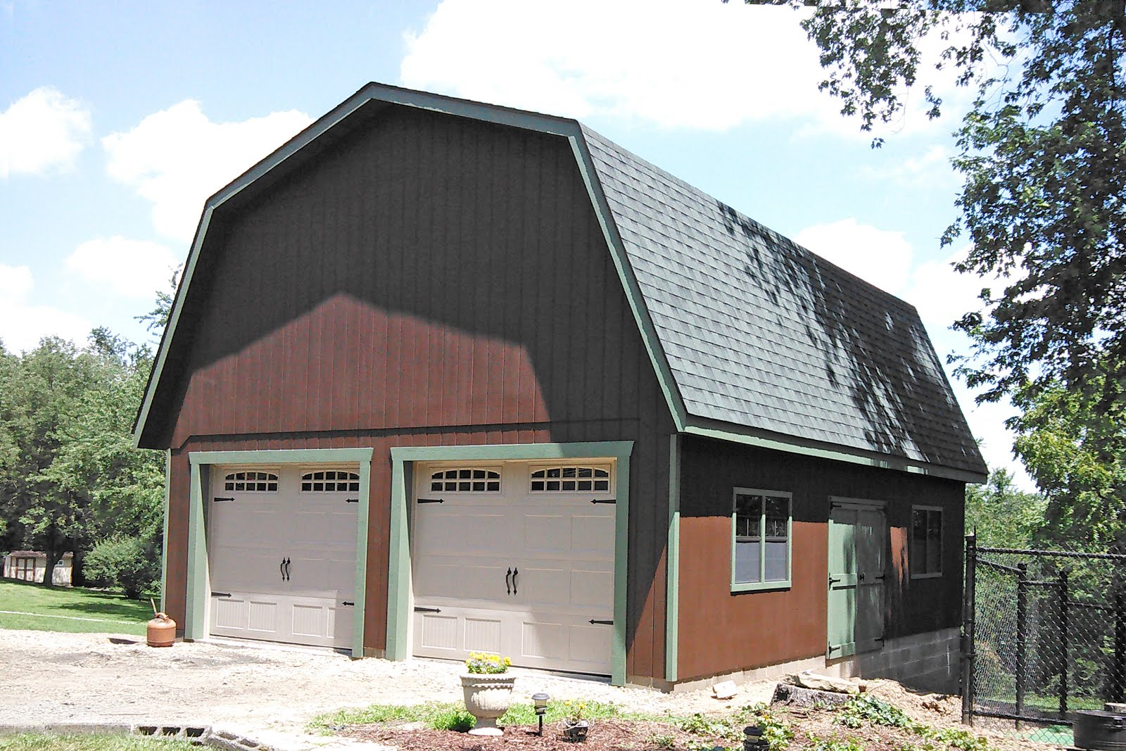 Three car garages in maryland and north carolina for Garage md carvin