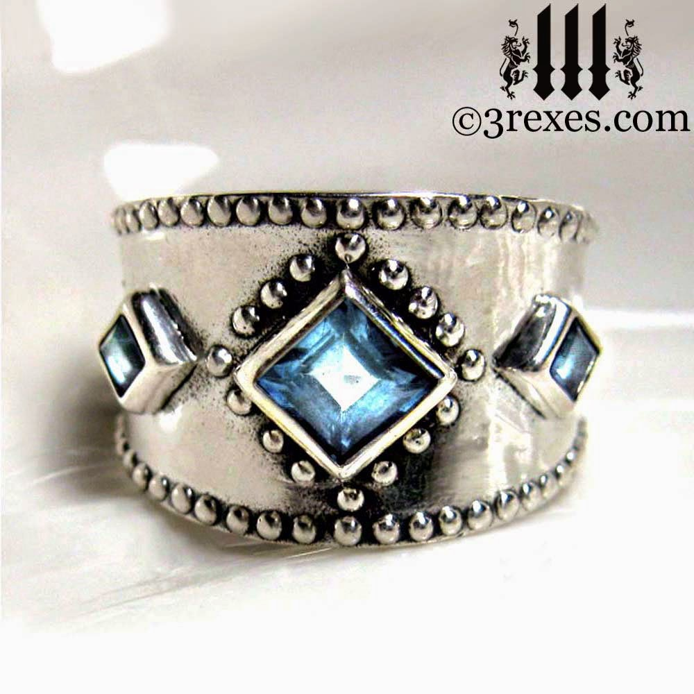 silver 3 wishes medieval wedding ring with blue topaz