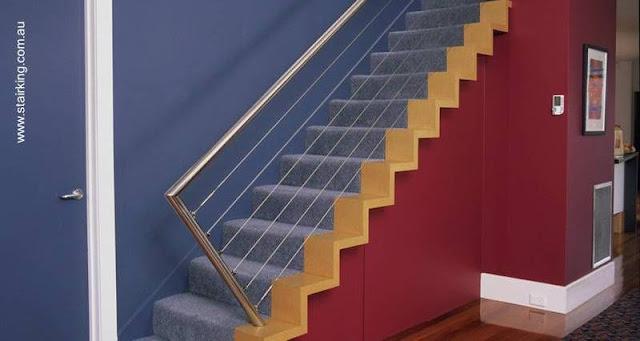 Escalera de interior estilo Contemporáneo con baranda metálica