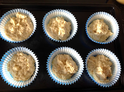 6 muffin cases with mixture inside
