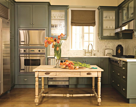 a darker green kitchen gets lightened up with a stripped oak table used as an island - Green Kitchen Table