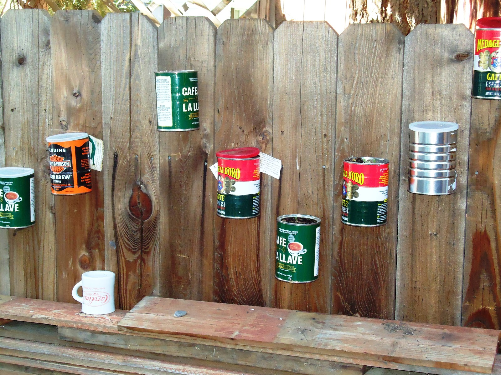 Recycled Miracles: Vertical coffee can garden