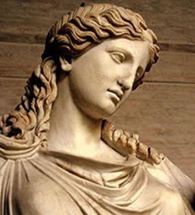 Irene o Eirene significa Aquella que trae la paz. Es una de las tres Horas, hijas de Zeus y Temis. Irene es la personificación de la paz y la riqueza y está representada en el arte como una joven y bella mujer llevando una cornucopia, un cetro y una antorcha o ritón. También se la puede representar con una corona de flores, una rama de olivo en la mano y una cornucopia en la otra, o también (como se puede observar en la foto), con Pluto, su hijo, en brazos. En la mitología romana su equivalente es la diosa Pax.