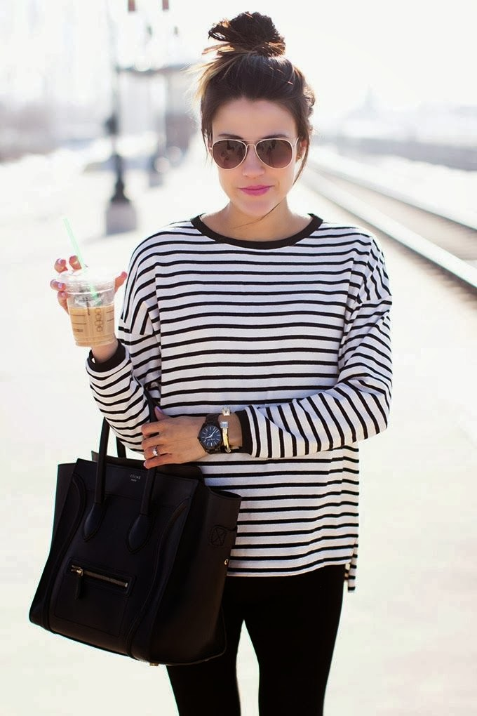 Striped shirt and black leather handbag