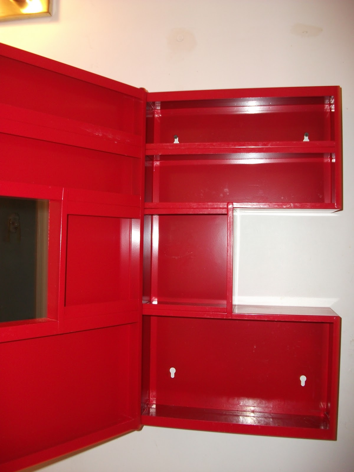 Moving out of Timmins sale: Red IKEA medicine Cabinet