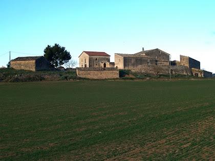 Vista de llevant de Cal Magí de les Alzines des del Camí de l'Espelt