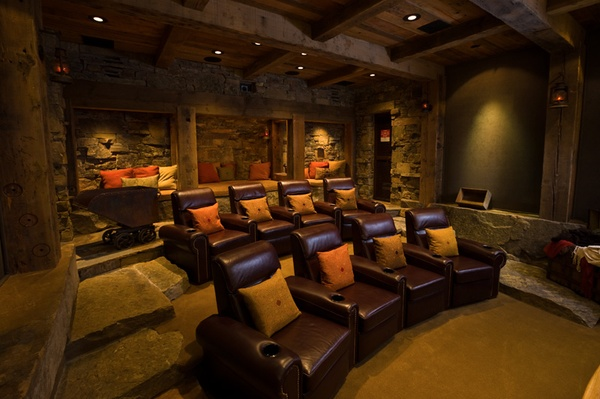 This home theater has a tiered seating effect, which is very ...