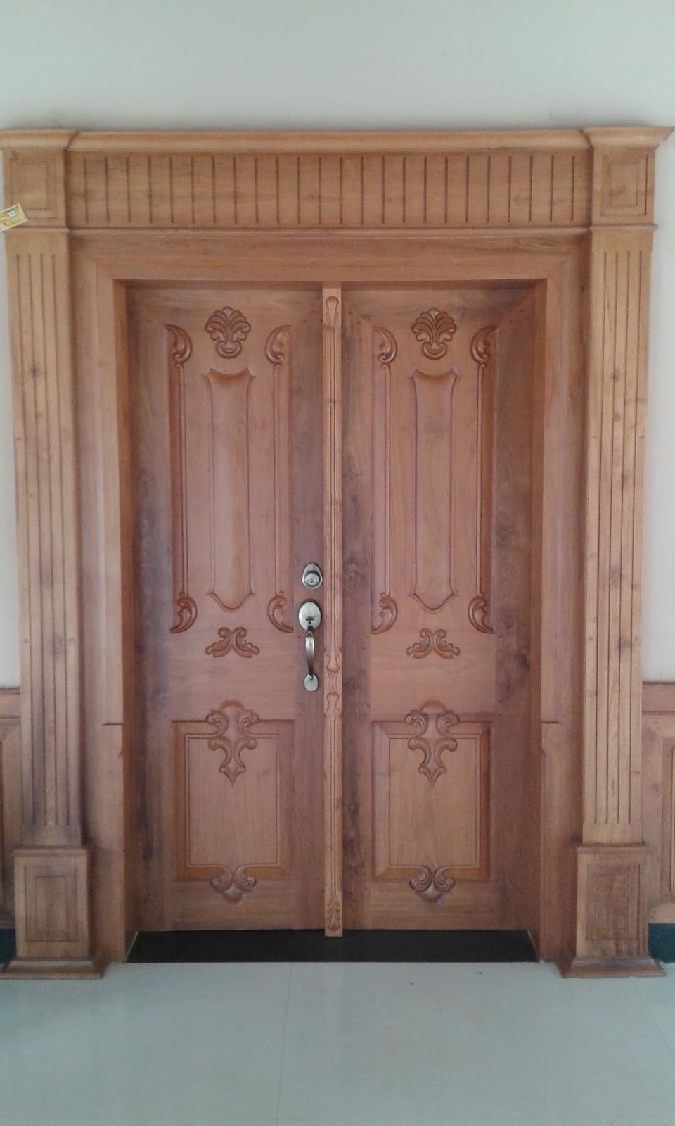 Kerala style carpenter works and designs may 2015 for House front double door design