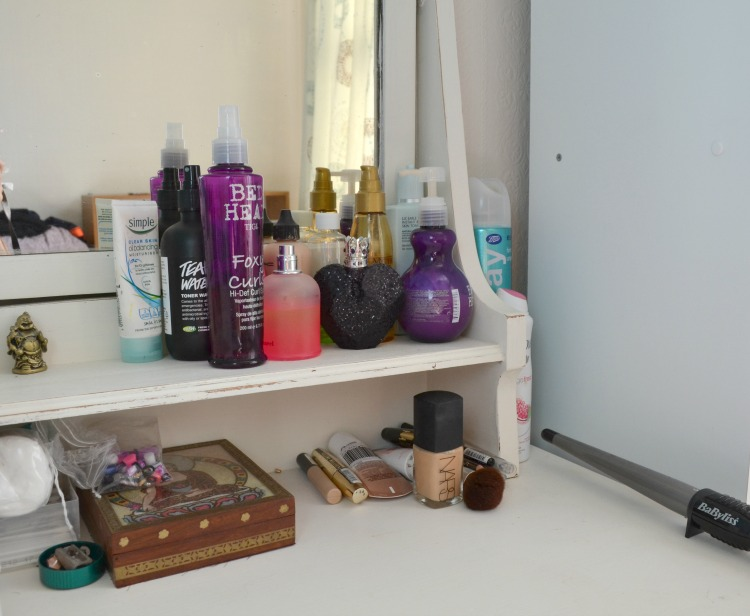 My Table Is Quite Handy As It Has A Little Shelf In Front Of The Mirror.  Here I Store A Mixture Of My Daily Hair And Skin Products And My Two  Perfumes.