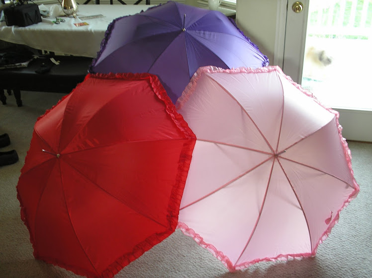 "red hat parasols 35"" tall, 47 "" opened"