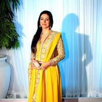 Tabu at a function in yellow salwar kameez