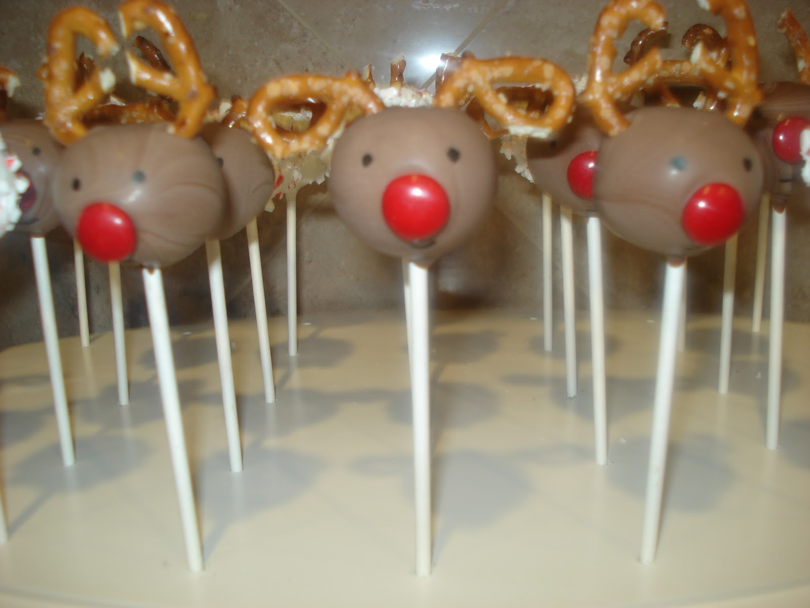 Rudolph Red Nosed Reindeer cake pops (oreo) and crushed candy cane ...