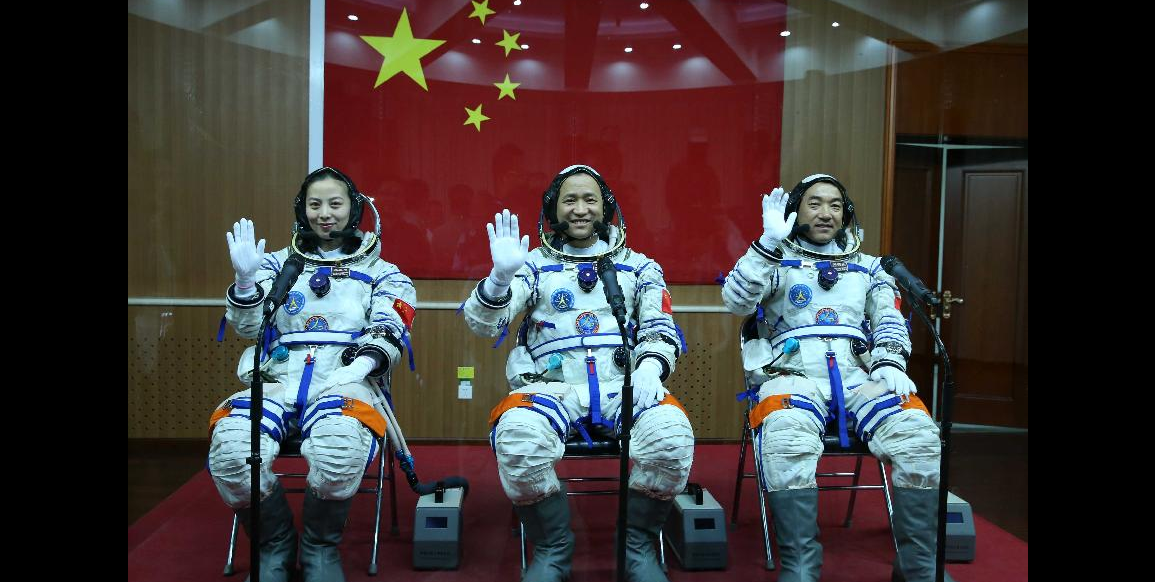 Astronauts Nie Haisheng (C), Zhang Xiaoguang (R) and Wang Yaping wave during the setting-out ceremony of the manned Shenzhou-10 mission at the Jiuquan Satellite Launch Center in Jiuquan, northwest China's Gansu Province, June 11, 2013. (Xinhua/Pang Xinglei)