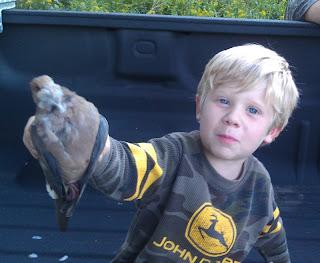 Son holding a dead dove