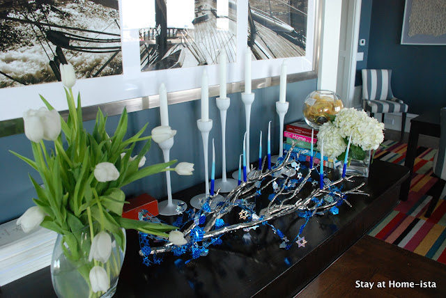 Hanukkah tablescape with menorah and candles