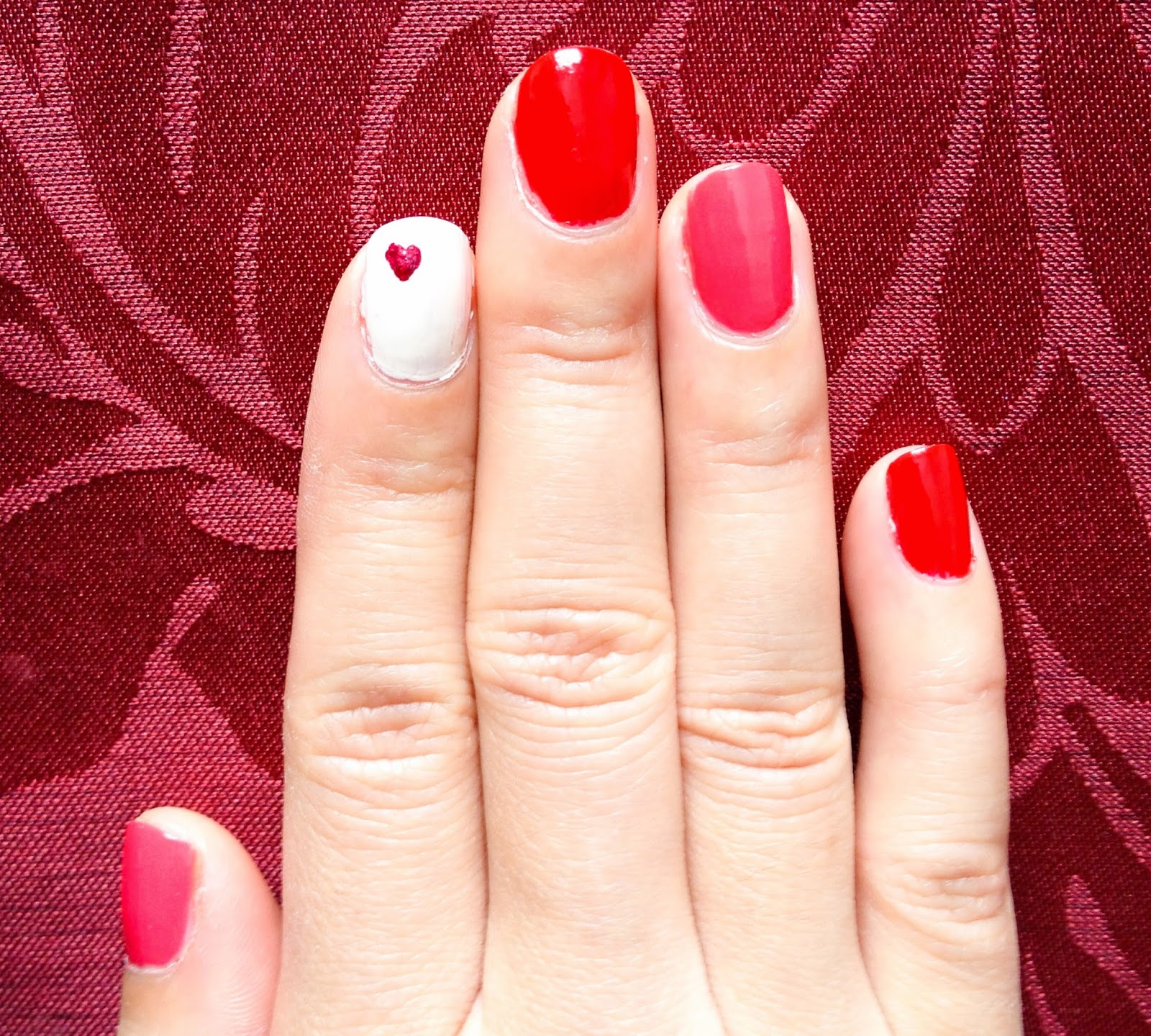 Valentine's Day nail art pink red hearts manicure