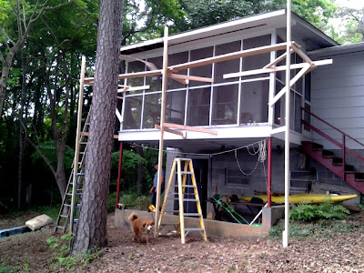 scaffolding on a Lake Norman lake house in need of serious repair to rafter tails, soffit, fascia, roof, etc.