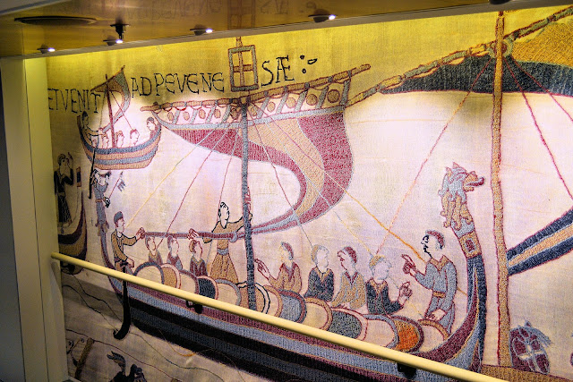 Along the back walls of the stairways from the top deck to the bottom, you can retrace the Norman conquest of England in these reproductions of the Bayeux Tapestry.
