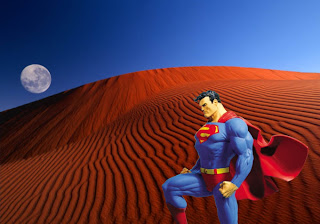 Superman free wallpapers Superman posters Statue in Red Moon Desert background