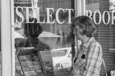A woman looks into a bookshop window - Cape Town Street Photograph