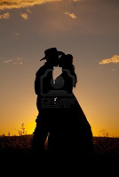 cowboy & cowgirl kissing silhouette