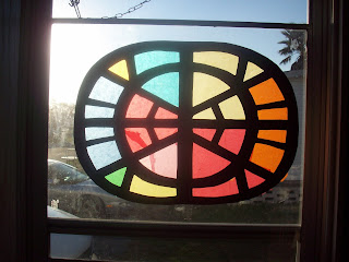 Stain Glass Windows with light shinning through them