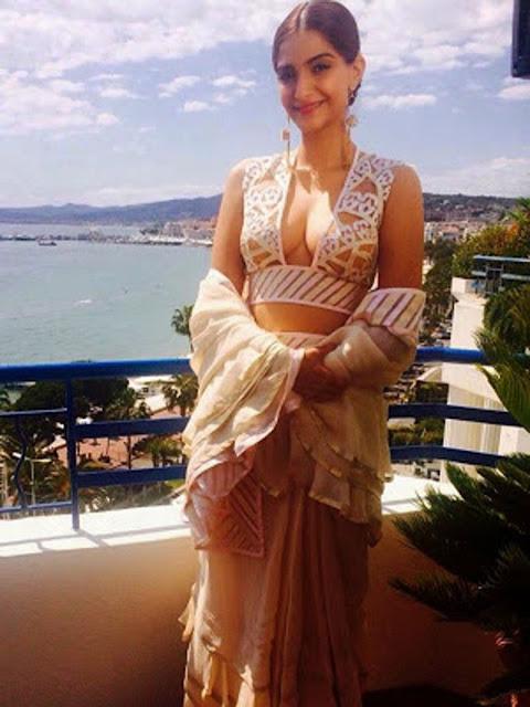 Sonam Kapoor wears Abu Sandeep Saree for media rounds and Launches Vikas Khanna's Book at Cannes 2015