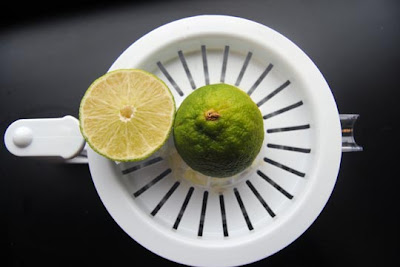 Limes being juiced with the Weston Manual Kitchen Kit