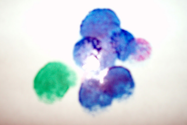 blue and green fingerprint painting